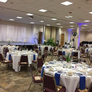 Round banquet tables and a stage