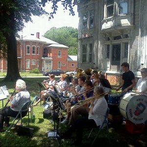 A band playing on the Gill House lawn