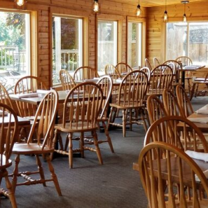 Patio room with wooden tables and chairs